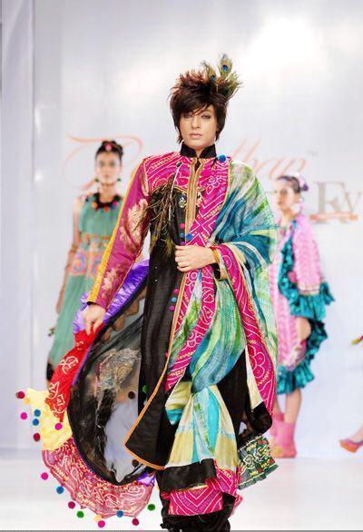 Designer Rohit Verma walking through ramp showcasing his new collection.jpeg